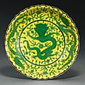 A yellow-ground green-enamelled Dragon saucer, Qianlong seal mark and period
