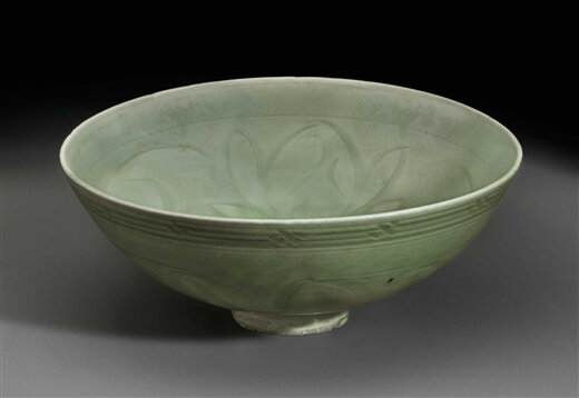 A Longquan celadon carved bowl, China, Yuan-Ming Dynasty (1279-1644)