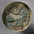 Small erotic mirror, late 13th century-mid 14th century, china, yuan dynasty