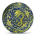 An underglaze-blue and yellow-enameled 'dragon' dish, qianlong seal mark and period (1736-1795)