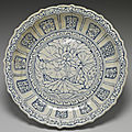 Vietnamese white dish with foliated rim and lotus flower décor in underglaze blue.15th Century