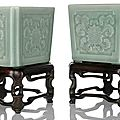 A fine and rare pair of celadon-glazed lotus porcelain jardinières on wood stands, China, Qianlong seal marks and period