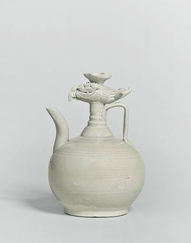 A glazed white stoneware phoenix-head ewer, Northern Song dynasty
