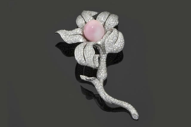 A diamond and conch pearl brooch