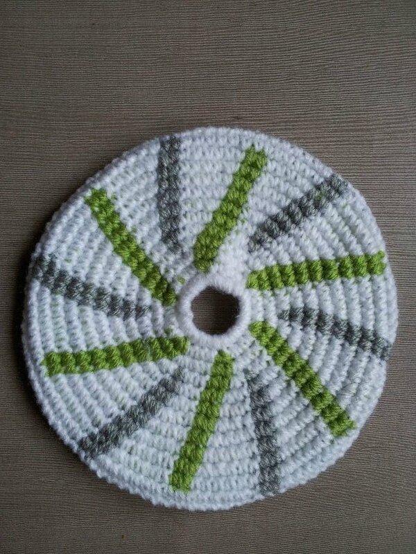 frisbee tourbillon vert et gris