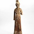 A rare painted and gold-foiled wood figure of a court lady, tang dynasty (618-907)
