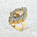 A 5.25 carats fancy brown-yellow marquise-cut diamond and diamond ring, by andrew grima