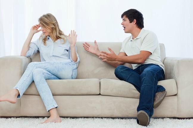 young-couple-arguing-on-a-sofa-136381366849303901-130702114836