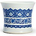 A blue and white 'lotus-scroll' brushpot, Qing dynasty, Kangxi period