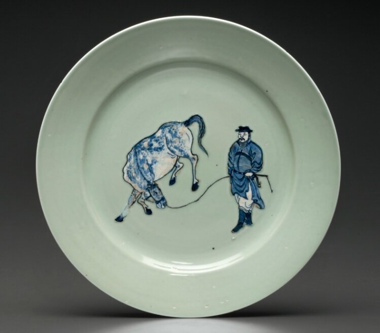An unusual underglaze-blue and copper-red-decorated celadon-ground dish, Kangxi period, circa 1675-1700
