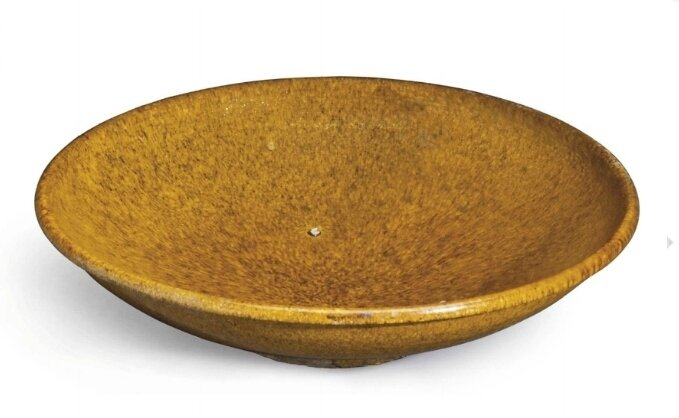 An amber-glazed dish, China, Liao Dynasty (AD 907-1125)