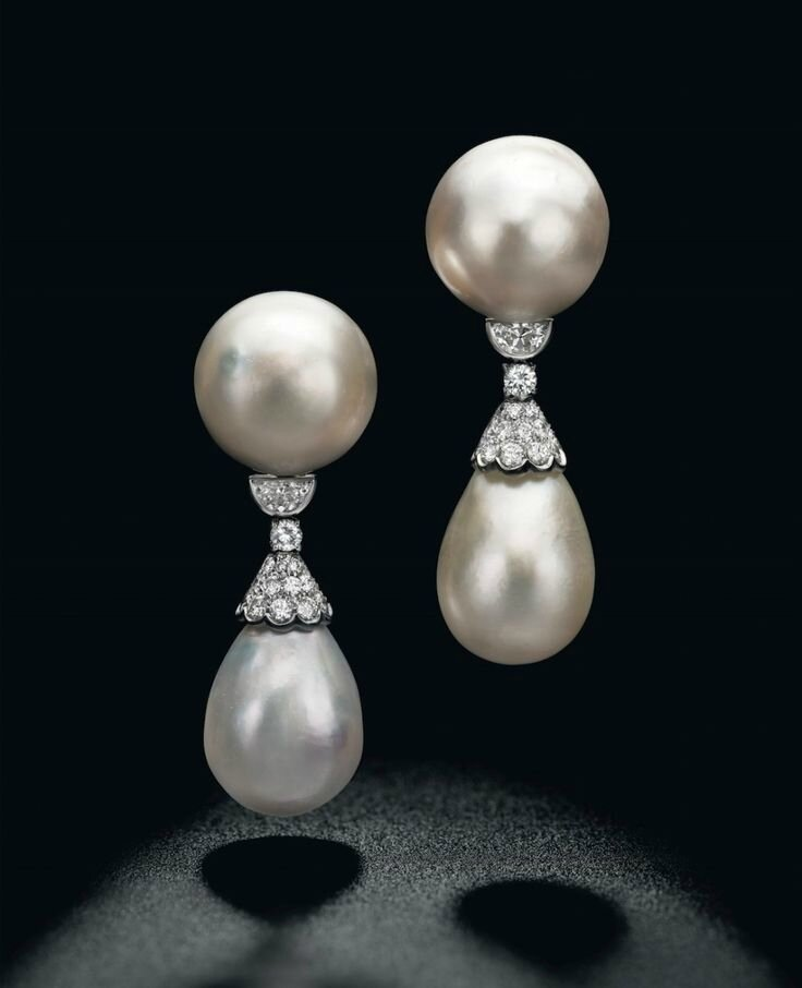 An exceptional pair of natural pearl and diamond ear pendants