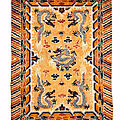 A large 'five-dragon' silk carpet for the hall of protecting harmony, circa 1900