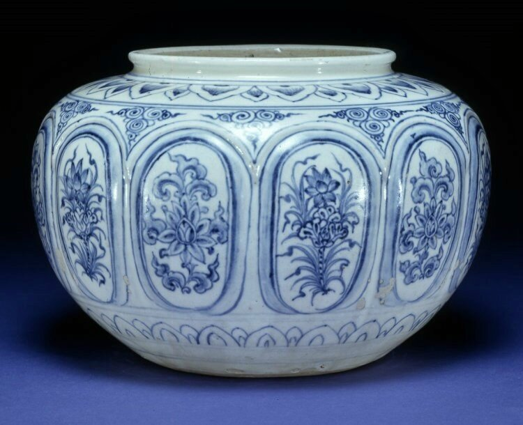 Jar with moulded panels painted with different forms of the lotus flower. Decorated in underglaze blue. Red River Delta, northern Vietnam, 1450-1480, stoneware. Height: 16.5 centimetres. Diameter: 22.5 centimetres. Purchased from Bluett & Sons. 1928,1016.