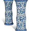 A pair of Chinese blue and white moulded vases, Kangxi period (1662-1722)