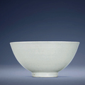 An early Ming white-glazedanhua-decorated bowl, Xuande six-character mark in underglaze blue within a double circle and of the period (1426-1435)