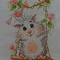 Hamster sur balançoire.