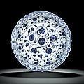 A rare barbed 'floral scroll' blue and white dish, Ming dynasty, Yongle period (1403-1425)