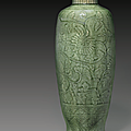 A carved Longquan celadon baluster vase, Early Ming dynasty, 14th-15th century