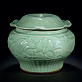 A Longquan celadon carved jar and cover, Yuan dynasty, 14th century