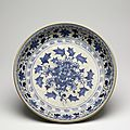 Very large blue-and-white dish, finely painted under the glaze in a vivid cobalt blue with a single large peony flower in the centre and floral scroll in the cavetto. Probably Chu Dau kilns, Red River Delta, northern Vietnam, 1440-1460, stoneware. Diameter