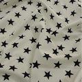 Tissu coton blanc à étoiles bleues marine