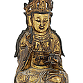 A gilt-bronze seated figure of guanyin, late ming dynasty (1368-1644)