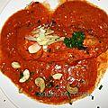 Escalopes de dinde à la sauce tomate/confit de poivrons